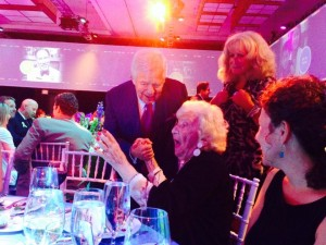 Robert Kraft congratulates Susan Wornick's Mother, Myrna, on Susan's award as one of the MGH One Hundred.
